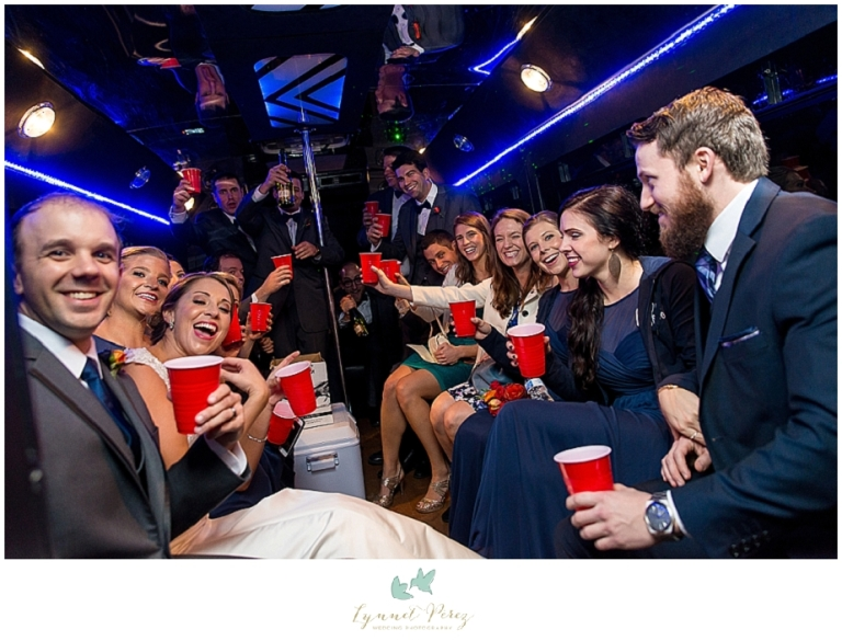 bridal-party-leaving-in-party-bus
