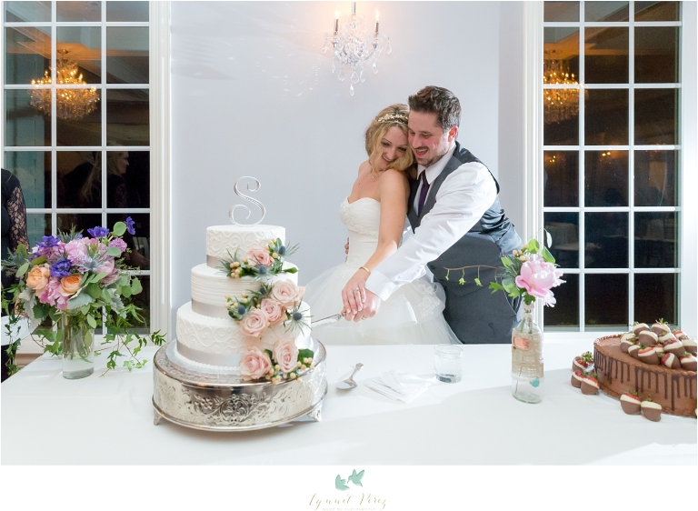 bride-and-groom-cutting-the-cake-wedding